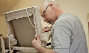 Sean at work in Carla Pyle's upholstery workshop